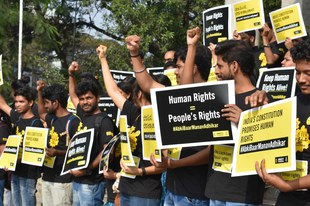Amnesty International Indien muss ihre Arbeit wegen der Regierung stoppen