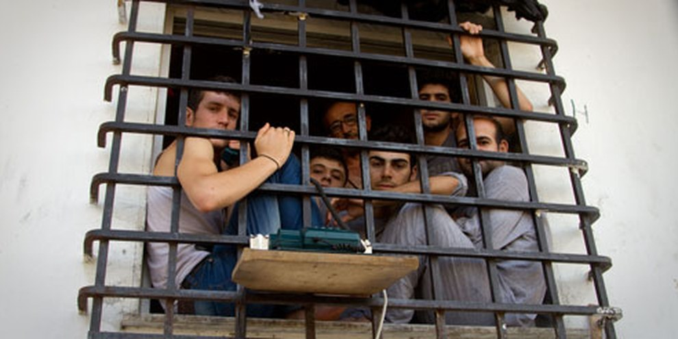 Diese Migranten werden in der griechischen Stadt Tychero festgehalten. © Bradley Secker / Demotix