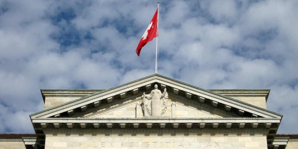 Il existe enfin depuis l'an dernier une «stratégie droits de l'homme» en matière de politique extérieure de la Suisse, mais elle demeure cantonnée au Département fédéral des Affaires étrangères.© Norbert Aepli