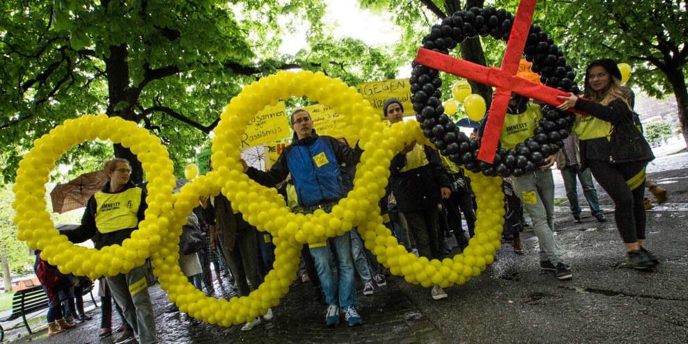 Lancement de la campagne Rio «Cinq anneaux pour Rio. Une flamme pour les droits humains» © Klaus Petrus