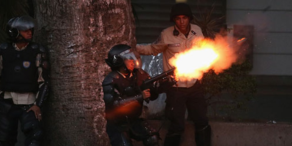 La police s'en est prise aux manifestants anti-gouvernement en mars 2014, à Caracas. © John Moore/Getty Images
