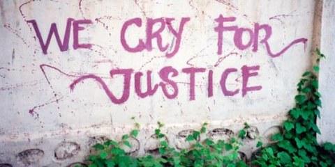 Un graffiti au Timor oriental: les victimes demandent justice. © AI