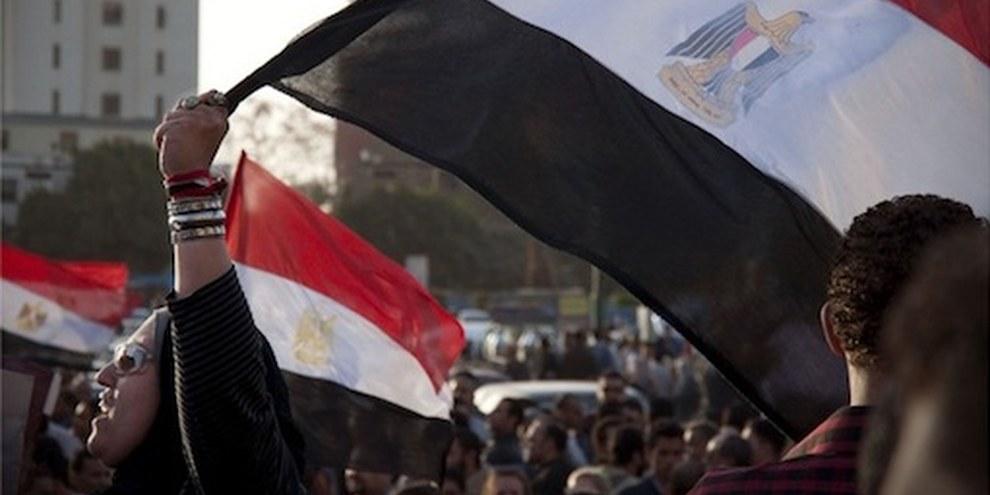 Ce mois de décembre 2011, les femmes militantes ont été violemment réprimées par les forces militaires armées. © JoAnna Pollonais/Demotix