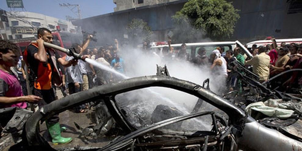 En juillet 2014, des frappes israéliennes ont fait de nombreux morts dans la bande de Gaza. © MOHAMMED ABED/AFP/Getty Images)