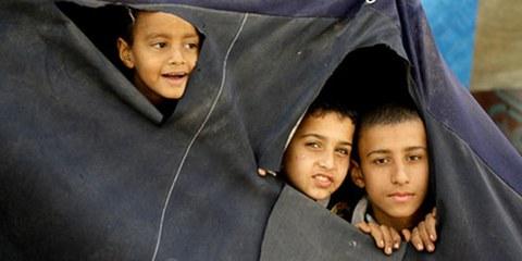 Ces jeunes réfugiés palestiniens ont dû fuir le camp de Yamuk, en Syrie. © AFP/Getty Images