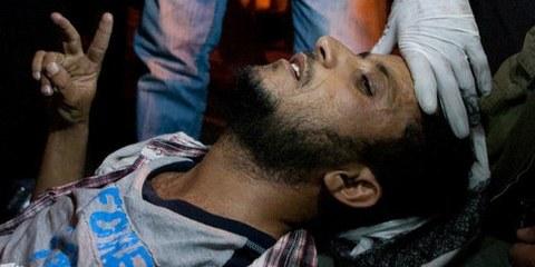Manifestant blessé à Sanaa, le 22 février 2011. © Giulio Petrocco/Demotix