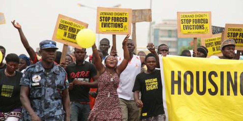 """Demonstration """"People live here"""", Ghana, 2011 © AI"""