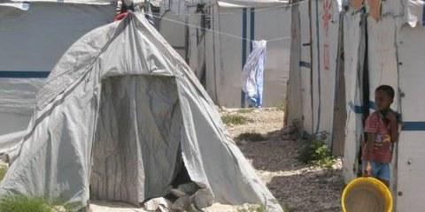 Plus de deux ans après le tremblement de terre qui a dévasté Haïti, environ 500 000 personnes vivent encore dans des campements. © AI