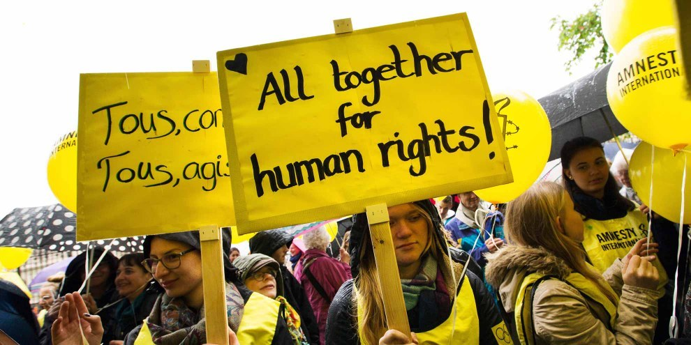 Azione di Amnesty Svizzera nel corso dell'annuale Assemblea generale, aprile 2016 © Klaus Petrus